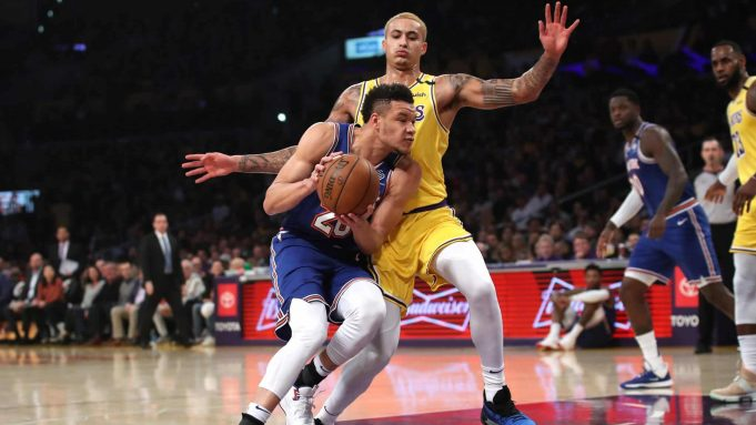 LOS ANGELES, CALIFORNIA - JANUARY 07: Kyle Kuzma #0 of the Los Angeles Lakers defends against Kevin Knox II #20 of the New York Knicks during the first half of a game at Staples Center on January 07, 2020 in Los Angeles, California. NOTE TO USER: User expressly acknowledges and agrees that, by downloading and/or using this photograph, user is consenting to the terms and conditions of the Getty Images License Agreement
