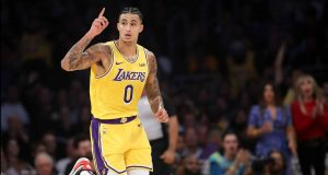 LOS ANGELES, CALIFORNIA - NOVEMBER 19: Kyle Kuzma #0 of the Los Angeles Lakers reacts after making a three point shot during the first half of a game against the Oklahoma City Thunder at Staples Center on November 19, 2019 in Los Angeles, California. NOTE TO USER: User expressly acknowledges and agrees that, by downloading and/or using this photograph, user is consenting to the terms and conditions of the Getty Images License Agreement