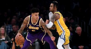LOS ANGELES, CALIFORNIA - NOVEMBER 13: Kyle Kuzma #0 of the Los Angeles Lakers posts up D'Angelo Russell #0 of the Golden State Warriors during a 120-94 Lakers win at Staples Center on November 13, 2019 in Los Angeles, California. NOTE TO USER: User expressly acknowledges and agrees that, by downloading and/or using this photograph, user is consenting to the terms and conditions of the Getty Images License Agreement.