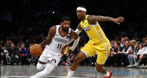 NEW YORK, NEW YORK - JANUARY 23: Kyrie Irving #11 of the Brooklyn Nets drives towards the basket against Kentavious Caldwell-Pope #1 of the Los Angeles Lakers at Barclays Center on January 23, 2020 in New York City. NOTE TO USER: User expressly acknowledges and agrees that, by downloading and or using this photograph, User is consenting to the terms and conditions of the Getty Images License Agreement.