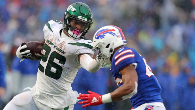ORCHARD PARK, NY - DECEMBER 29: Le'Veon Bell #26 of the New York Jets runs the ball and tries to block Jaquan Johnson #46 of the Buffalo Bills during the first half at New Era Field on December 29, 2019 in Orchard Park, New York.