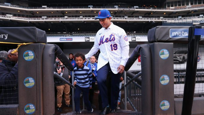 NEW YORK, NY - JANUARY 24: Luis Rojas, the new manager of the New York Mets walks onto the field with his son Luis Felipe, after his introductory press conference at Citi Field on January 24, 2020 in New York City.