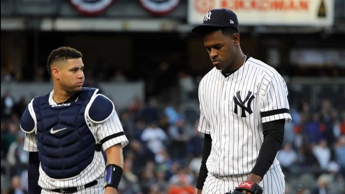 NEW YORK, NEW YORK - OCTOBER 15: Luis Severino #40 and Gary Sanchez #24 of the New York Yankees walk to the dugout prior to the fifth inning as the home plate umpire is replaced in game three of the American League Championship Series at Yankee Stadium on October 15, 2019 in New York City.