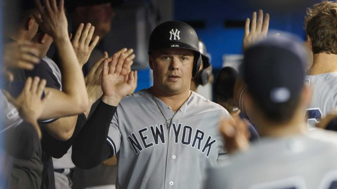 TORONTO, ON - SEPTEMBER 13: Luke Voit #45 of the New York Yankees celebrates a run in the dugout as he's brought home by Gleyber Torres #25 during the fifth inning of their MLB game against the Toronto Blue Jays at Rogers Centre on September 13, 2019 in Toronto, Canada.