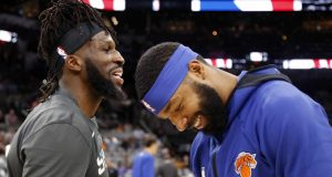 SAN ANTONIO,TX - OCTOBER 23: Marcus Morris #13 of the New York Knicks jokes with DeMarre Carroll #77 of the San Antonio Spurs before the start of their game at AT&T Center on October 23 , 2019 in San Antonio, Texas. NOTE TO USER: User expressly acknowledges and agrees that , by downloading and or using this photograph, User is consenting to the terms and conditions of the Getty Images License Agreement.