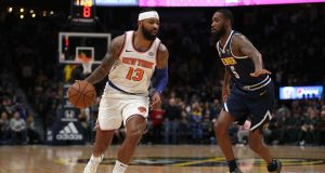 DENVER, COLORADO - DECEMBER 15: Marcus Morris Sr. #13 of the New York Knicks drives against Will Barton III #5 of the Denver Nuggets in the first quarter at the Pepsi Center on December 15, 2019 in Denver, Colorado. NOTE TO USER: User expressly acknowledges and agrees that, by downloading and or using this photograph, User is consenting to the terms and conditions of the Getty Images License Agreement.