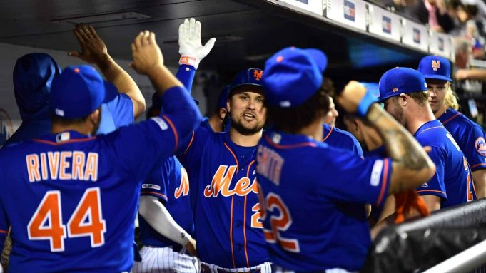 NEW YORK, NEW YORK - SEPTEMBER 27: J.D. Davis #28 of the New York Mets celebrates with teammates after his home run in the fourth inning of their game against the Atlanta Braves at Citi Field on September 27, 2019 in the Flushing neighborhood of the Queens borough of New York City.