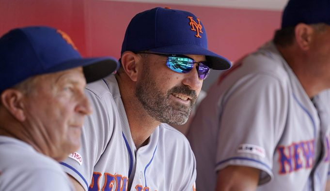 CINCINNATI, OHIO - SEPTEMBER 22: Mickey Callaway #36 manager of the New York Mets sits in the dugout during the game against the Cincinnati Reds at Great American Ball Park on September 22, 2019 in Cincinnati, Ohio.