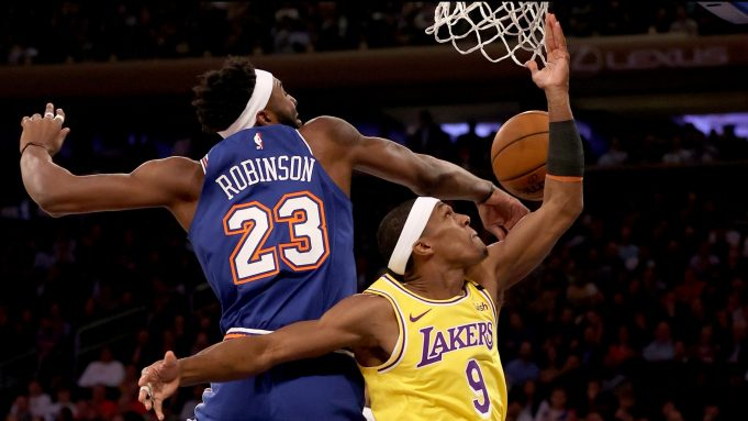 NEW YORK, NEW YORK - JANUARY 22: Rajon Rondo #9 of the Los Angeles Lakers heads for the basket as Mitchell Robinson #23 of the New York Knicks defends at Madison Square Garden on January 22, 2020 in New York City.NOTE TO USER: User expressly acknowledges and agrees that, by downloading and or using this photograph, User is consenting to the terms and conditions of the Getty Images License Agreement.