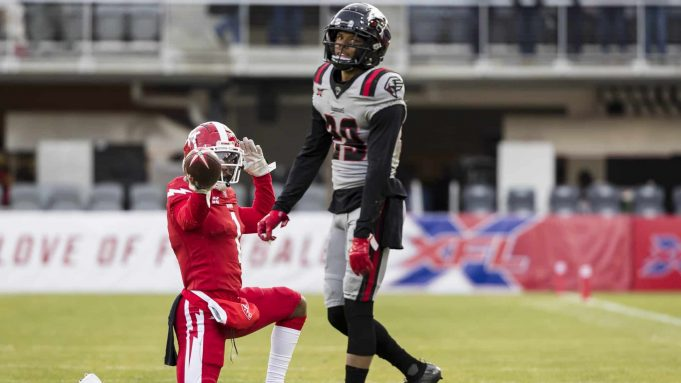 WASHINGTON, DC - FEBRUARY 15: DeAndre Thompkins #1 of the DC Defenders celebrates in front of Bryce Jones #29 of the NY Guardians after a first down during the second half of the XFL game at Audi Field on February 15, 2020 in Washington, DC.