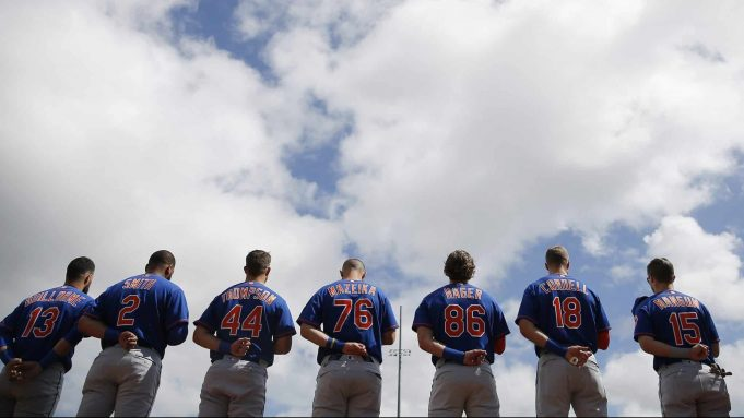 JUPITER, FLORIDA - FEBRUARY 22: The New York Mets observe the playing of the national anthem prior to a Grapefruit League spring training game against the St. Louis Cardinals at Roger Dean Stadium on February 22, 2020 in Jupiter, Florida.