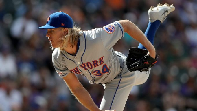 DENVER, COLORADO - SEPTEMBER 18: Starting pitcher Noah Syndergaard #34 of the New York Mets throws in the sixth inning against the Colorado Rockies at Coors Field on September 18, 2019 in Denver, Colorado.