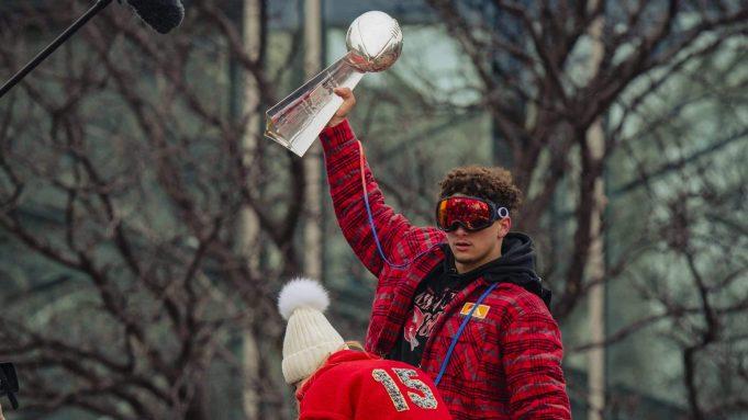 KANSAS CITY, MO - FEBRUARY 05: Patrick Mahomes #15 of the Kansas City Chiefs hoists the Vince Lombardi Trophy during the Kansas City Chiefs Victory Parade on February 5, 2020 in Kansas City, Missouri.