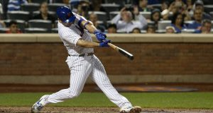 NEW YORK, NEW YORK - SEPTEMBER 28: Pete Alonso #20 of the New York Mets connects on his third inning home run against the Atlanta Braves at Citi Field on September 28, 2019 in New York City. The home run was Alonso's 53rd of the season, breaking Aaron Judge's rookie record.