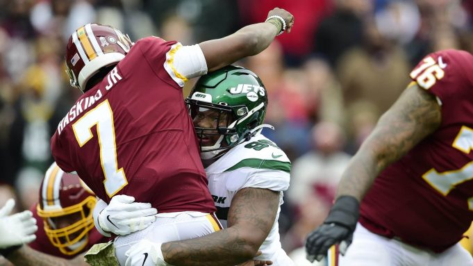 LANDOVER, MD - NOVEMBER 17: Dwayne Haskins #7 of the Washington Redskins is tackled by Quinnen Williams #95 of the New York Jets after throwing a pass in the first quarter at FedExField on November 17, 2019 in Landover, Maryland.