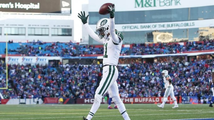 BUFFALO, NY - DECEMBER 09: Robby Anderson #11 of the New York Jets celebrates after scoring a touchdown in the fourth quarter during NFL game action against the Buffalo Bills at New Era Field on December 9, 2018 in Buffalo, New York.