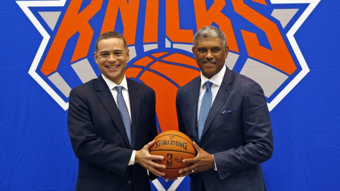 This July 17, 2017, file photo shows New York Knicks general manager Scott Perry (left) and president Steve Mills posing for a picture after a news conference in Greenburgh, New York. Mills and Perry are trying to change the identity of the New York Knicks.