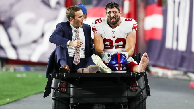 FOXBOROUGH, MA - AUGUST 29: Scott Simonson #82 of the New York Giants is carted off the field after an injury during a preseason game against the New England Patriots at Gillette Stadium on August 29, 2019 in Foxborough, Massachusetts.