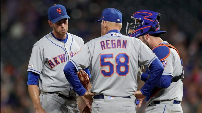 DENVER, COLORADO - SEPTEMBER 16: Starting pitcher Steven Matz #32 , pitching coach Phil Regan #58 and catcher Tomas Nido #3 of the New York Mets confer in the fourth inning against the Colorado Rockies at Coors Field on September 16, 2019 in Denver, Colorado.