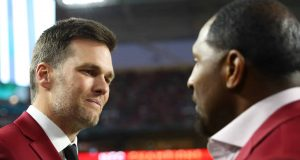 MIAMI, FLORIDA - FEBRUARY 02: Tom Brady of the New England Patriots talks with NFL Hall of Famer Ray Lewis of the Baltimore Ravens prior to Super Bowl LIV between the San Francisco 49ers and the Kansas City Chiefs at Hard Rock Stadium on February 02, 2020 in Miami, Florida.