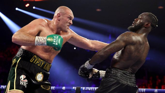 LAS VEGAS, NEVADA - FEBRUARY 22: Tyson Fury (L) punches Deontay Wilder during their Heavyweight bout for Wilder's WBC and Fury's lineal heavyweight title on February 22, 2020 at MGM Grand Garden Arena in Las Vegas, Nevada.