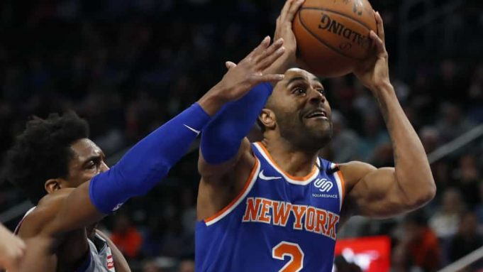 New York Knicks guard Wayne Ellington (2) attempts to shoot as Detroit Pistons guard Langston Galloway defends during the first half of an NBA basketball game, Saturday, Feb. 8, 2020, in Detroit.