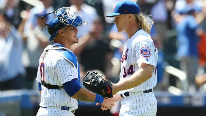 NEW YORK, NEW YORK - MAY 02: Noah Syndergaard #34 of the New York Mets celebrates with Wilson Ramos #40 after pitching a complete game shutout against the Cincinnati Reds at Citi Field on May 02, 2019 in the Queens borough of New York City. New York Mets defeated the Cincinnati Reds 1-0.
