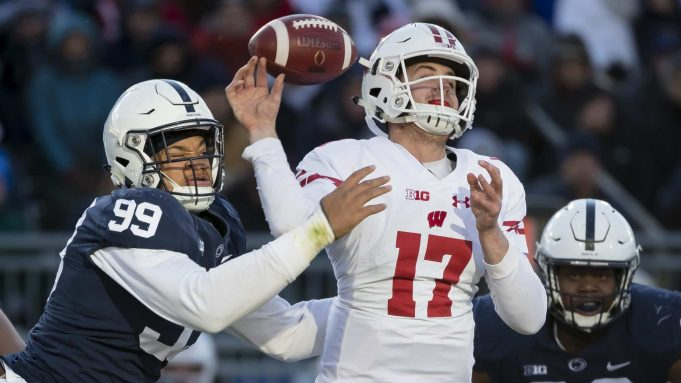 STATE COLLEGE, PA - NOVEMBER 10: Yetur Gross-Matos #99 of the Penn State Nittany Lions hits the arm of Jack Coan #17 of the Wisconsin Badgers as he throws during the second half at Beaver Stadium on November 10, 2018 in State College, Pennsylvania.