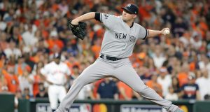 HOUSTON, TEXAS - OCTOBER 19: Zack Britton #53 of the New York Yankees delivers the pitch against the Houston Astros during the eighth inning in game six of the American League Championship Series at Minute Maid Park on October 19, 2019 in Houston, Texas.