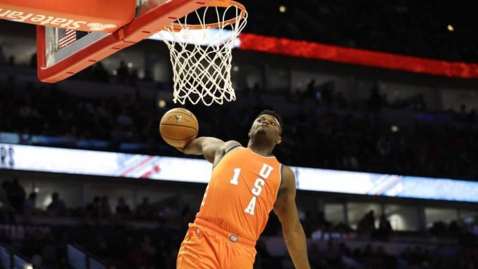 Team USA forward Zion Williamson, of the New Orleans Pelicans, goes up for a dunk against Team World during the second half of the NBA Rising Stars basketball game in Chicago, Friday, Feb. 14, 2020.