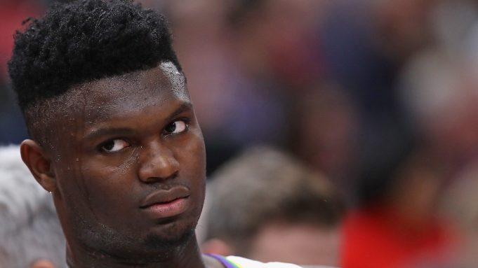 CHICAGO, ILLINOIS - FEBRUARY 06: Zion Williamson #1 of the New Orleans Pelicans watches from the bench as teammates take on the Chicago Bulls at the United Center on February 06, 2020 in Chicago, Illinois. NOTE TO USER: User expressly acknowledges and agrees that, by downloading and or using this photograph, User is consenting to the terms and conditions of the Getty Images License Agreement.