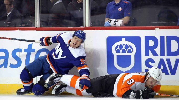 NEW YORK, NEW YORK - FEBRUARY 11: Casey Cizikas #53 of the New York Islanders is injured as he checks Ivan Provorov #9 of the Philadelphia Flyers during the first period at the Barclays Center on February 11, 2020 in the Brooklyn borough of New York City.
