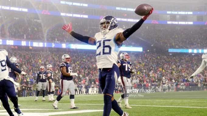 FOXBOROUGH, MASSACHUSETTS - JANUARY 04: Logan Ryan #26 of the Tennessee Titans scores a touchdown against the New England Patriots in the fourth quarter of the AFC Wild Card Playoff game at Gillette Stadium on January 04, 2020 in Foxborough, Massachusetts.