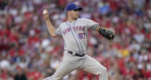 CINCINNATI, OHIO - SEPTEMBER 21: Seth Lugo #67 of the New York Mets pitches during the game against the Cincinnati Reds at Great American Ball Park on September 21, 2019 in Cincinnati, Ohio.
