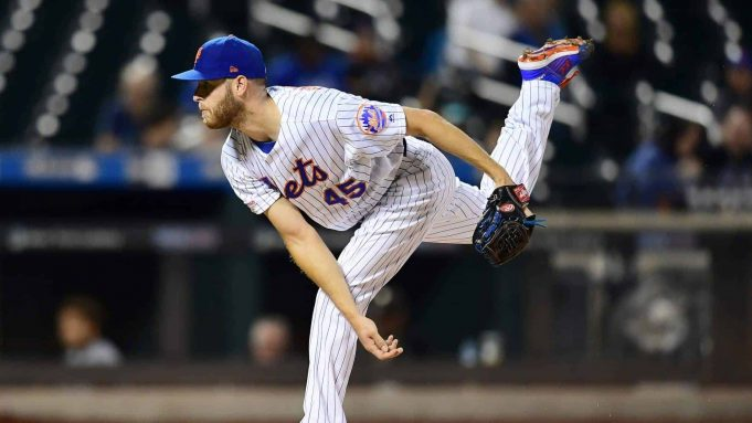NEW YORK, NEW YORK - SEPTEMBER 26: Zack Wheeler #45 of the New York Mets follows through with a pitch in the first inning of their game against the Miami Marlins at Citi Field on September 26, 2019 in the Flushing neighborhood of the Queens borough in New York City.