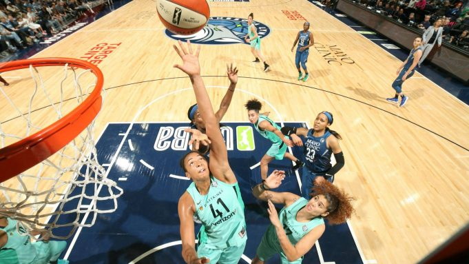 Kiah Stokes (41) of the New York Liberty reaches for the ball against the Minnesota Lynx on June 16 at Target Center in Minneapolis.