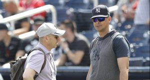 WEST PALM BEACH, FLORIDA - MARCH 12: New York Yankees general manager Brian Cashman talks with manager Aaron Boone prior to a Grapefruit League spring training game against the Washington Nationals at FITTEAM Ballpark of The Palm Beaches on March 12, 2020 in West Palm Beach, Florida. Many professional and college sports are canceling or postponing their games due to the ongoing threat of the Coronavirus (COVID-19) outbreak.