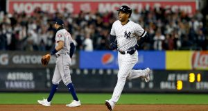 NEW YORK, NEW YORK - OCTOBER 18: Aaron Hicks #31 of the New York Yankees rounds the bases after hitting a three run home run against Justin Verlander #35 of the Houston Astros during the first inning in game five of the American League Championship Series at Yankee Stadium on October 18, 2019 in New York City.