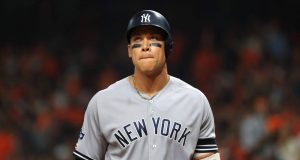HOUSTON, TEXAS - OCTOBER 13: Aaron Judge #99 of the New York Yankees reacts after flying out during the sixth inning against the Houston Astros in game two of the American League Championship Series at Minute Maid Park on October 13, 2019 in Houston, Texas.
