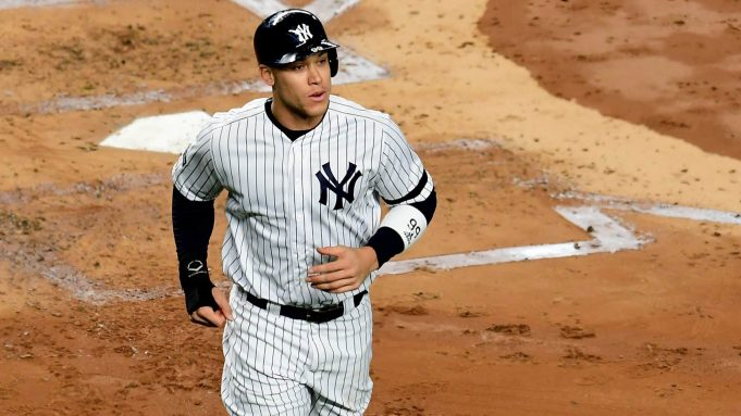 NEW YORK, NEW YORK - OCTOBER 17: Aaron Judge #99 of the New York Yankees looks on after scoring a run on a walk in the first inning against the Houston Astros during game three of the American League Championship Series at Yankee Stadium on October 17, 2019 in the Bronx borough of New York City.