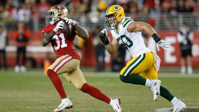 SANTA CLARA, CALIFORNIA - NOVEMBER 24: Raheem Mostert #31 of the San Francisco 49ers runs with the ball after making a catch in the fourth quarter against the Green Bay Packers at Levi's Stadium on November 24, 2019 in Santa Clara, California.