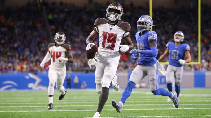 DETROIT, MICHIGAN - DECEMBER 15: Breshad Perriman #19 of the Tampa Bay Buccaneers scores a second quarter touchdown past Amani Oruwariye #24 of the Detroit Lions at Ford Field on December 15, 2019 in Detroit, Michigan.