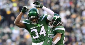 EAST RUTHERFORD, NEW JERSEY - DECEMBER 22: Brian Poole #34 and Darryl Roberts #27 of the New York Jets celebrate after a turnover on downs as their teams defeats the Pittsburgh Steelers 16-10 at MetLife Stadium on December 22, 2019 in East Rutherford, New Jersey.