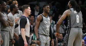 Brooklyn Nets guard Caris LeVert (22) celebrates with center DeAndre Jordan (6) late in overtime of the team's NBA basketball game against the Boston Celtics, Tuesday, March 3, 2020, in Boston.