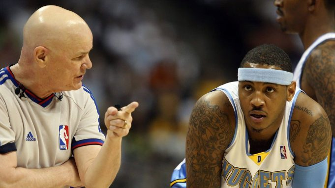 DENVER - MAY 29: Referee Joe Crawford talks with Carmelo Anthony #15 of the Denver Nuggets in Game Six of the Western Conference Finals during the 2009 NBA Playoffs against the Los Angeles Lakers at Pepsi Center on May 29, 2009 in Denver, Colorado. NOTE TO USER: User expressly acknowledges and agrees that, by downloading and or using this photograph, User is consenting to the terms and conditions of the Getty Images License Agreement.