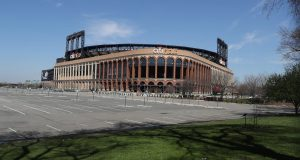 """FLUSHING, NEW YORK - MARCH 26: Citi Field is empty on the scheduled date for Opening Day March 26, 2020 in Flushing, New York. Major League Baseball has postponed the start of its season due to the coronavirus (COVID-19) outbreak and MLB commissioner Rob Manfred recently said the league is """"probably not gonna be able to"""" play a full 162 game regular season"""