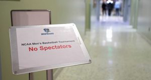 """BALTIMORE, MARYLAND - MARCH 06: A sign reads 'No Spectators"""" prior to Yeshiva playing against Worcester Polytechnic Institute during the NCAA Division III Men's Basketball Championship - First Round at Goldfarb Gymnasium on at Johns Hopkins University on March 6, 2020 in Baltimore, Maryland. On Thursday, Maryland Gov. Larry Hogan announced that Maryland had confirmed three cases of residents with COVID-19, otherwise known as the Coronavirus, prompting Johns Hopkins officials to host the NCAA men's basketball tournament without spectators."""