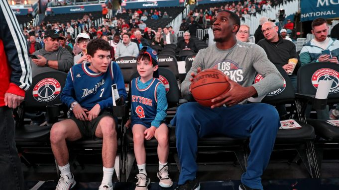 WASHINGTON, DC - MARCH 10: Damyean Dotson #21 of the New York Knicks sits nexts to fans on court-side seats before playing against the Washington Wizards at Capital One Arena on March 10, 2020 in Washington, DC. NOTE TO USER: User expressly acknowledges and agrees that, by downloading and or using this photograph, User is consenting to the terms and conditions of the Getty Images License Agreement.