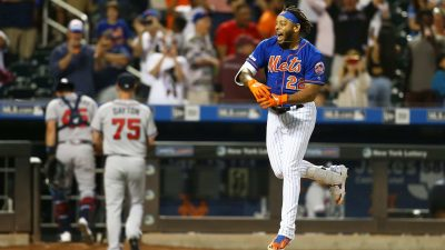 NEW YORK, NEW YORK - SEPTEMBER 29: Dominic Smith #22 of the New York Mets celebrates after hitting a walk-off 3-run home run in the bottom of the eleventh inning against the Atlanta Braves at Citi Field on September 29, 2019 in New York City.