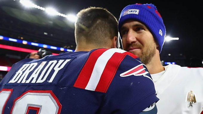 FOXBOROUGH, MASSACHUSETTS - OCTOBER 10: Tom Brady #12 of the New England Patriots shakes hands with Eli Manning #10 of the New York Giants after their game at Gillette Stadium on October 10, 2019 in Foxborough, Massachusetts. The New England Patriots defeated the New York Giants with a score of 35 to 14.